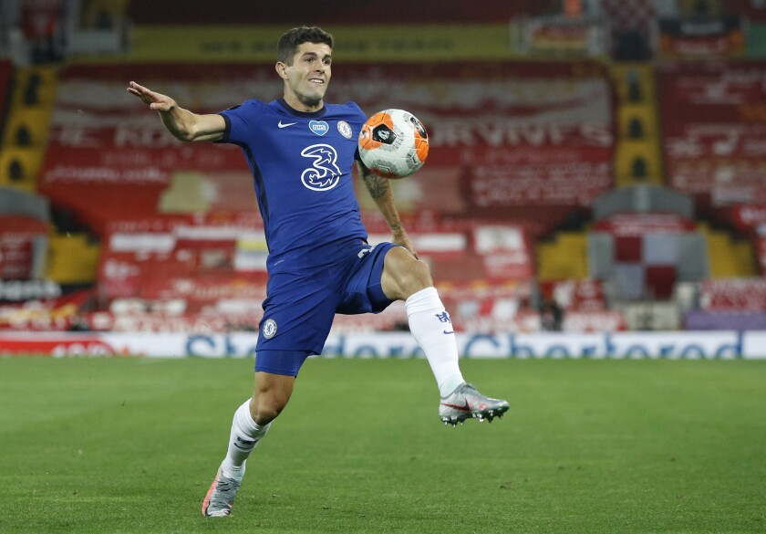 Chelsea's Christian Pulisic controls the ball during an English Premier League match.