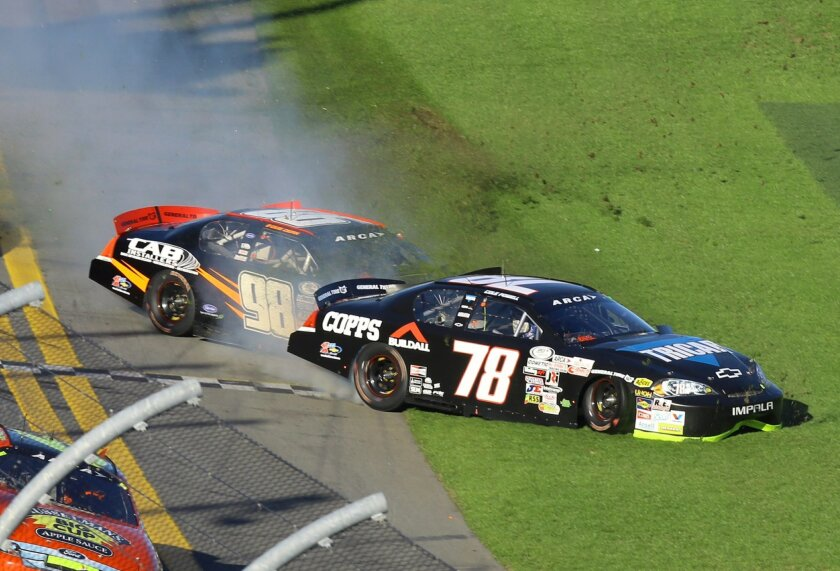 Cole Powell (78) and Gus Dean (98) wreck on the front stretch during the ARCA series auto race at Daytona International Speedway, Saturday, Feb. 13, 2016, in Daytona Beach, Fla. (AP Photo/David Graham)