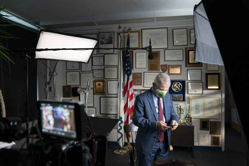 """This image released by National Geographic shows Dr. Anthony Fauci at the NIH in Bethesda, Md., during the filming of the documentary """"Fauci."""" John Hoffman and Janet Tobias's portrait of the director of the National Institute of Allergy and Infectious Diseases will screen only in theaters mandating vaccination and masking. (Visko Hatfield/National Geographic via AP)"""