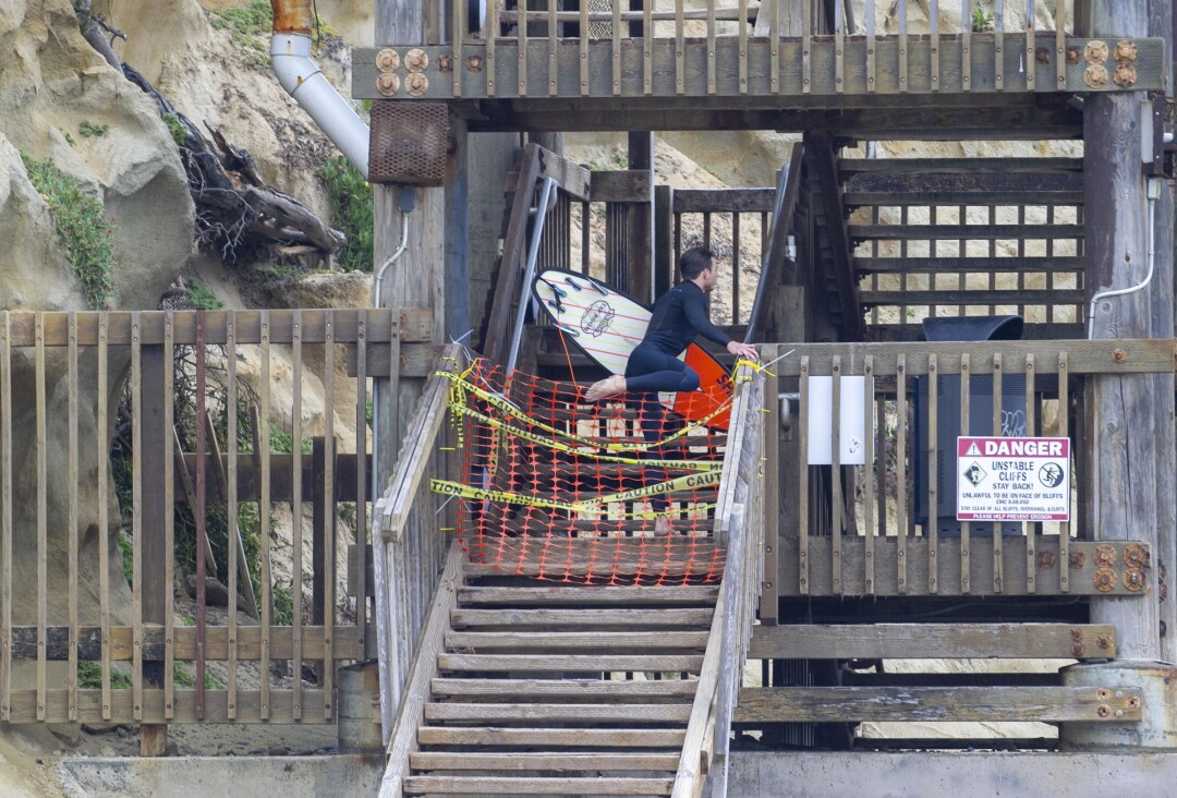All stairways up and down connecting the street and beaches are closed, but one surfer jumped the closure at the D street stairway. The City of Encinitas reopened their beaches in a limited manner at 8 a.m. on Monday, April 27, 2020 on a limited basis. They are trying to channel all beach users through the Moonlight Beach Park.