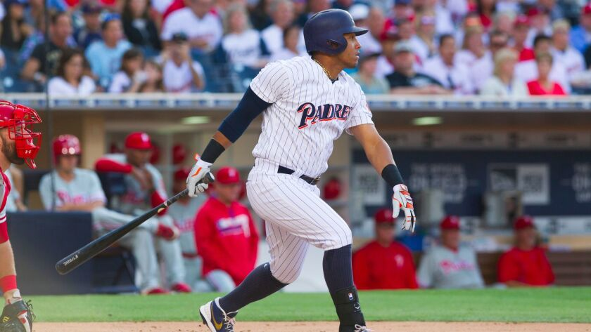 Padres third baseman Yangervis Solarte hits an RBI single that scored Travis Jankowski in the bottom of the first.