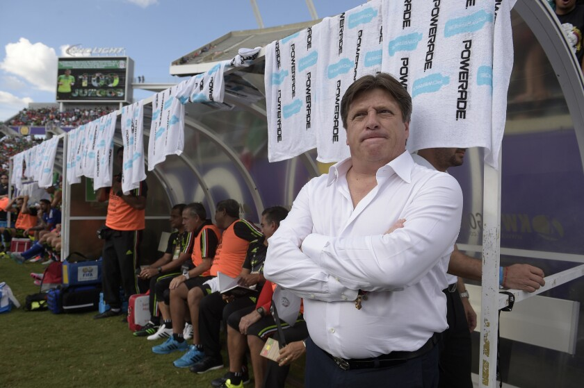 Mexico head coach Miguel Herrera, right, watches from the bench before a friendly soccer match against Costa Rica in Orlando, Fla., Saturday, June 27, 2015. (AP Photo/Phelan M. Ebenhack)