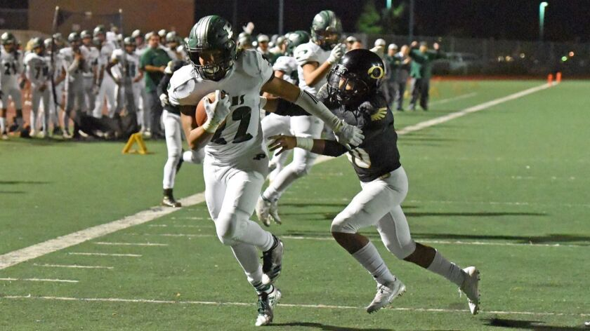Poway's Donovan Bercasio scores the first Titan touchdown Friday night against Olympian High School.