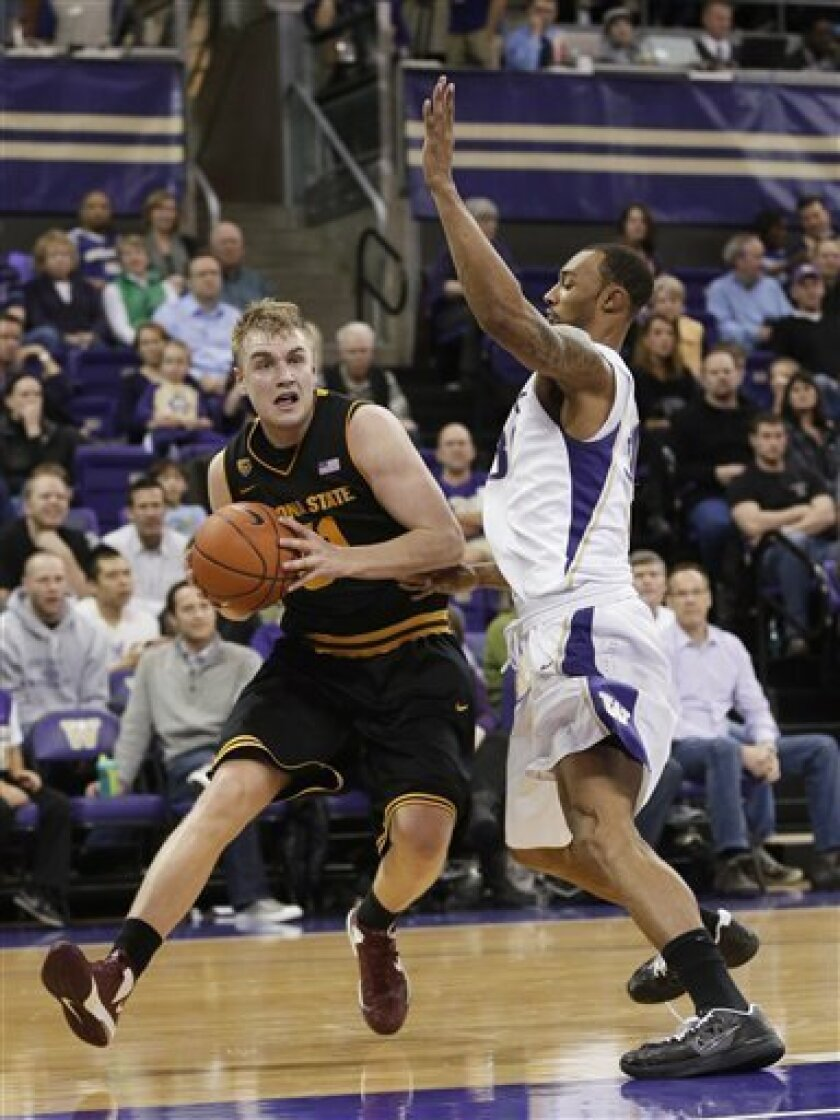 Washington's Desmond Simmons (30) defends as Arizona State's Jonathan Gilling, left, looks to pass in the second half of an NCAA college basketball game, Saturday, Feb. 2, 2013, in Seattle. Washington beat Arizona State 96-92. (AP Photo/Ted S. Warren)