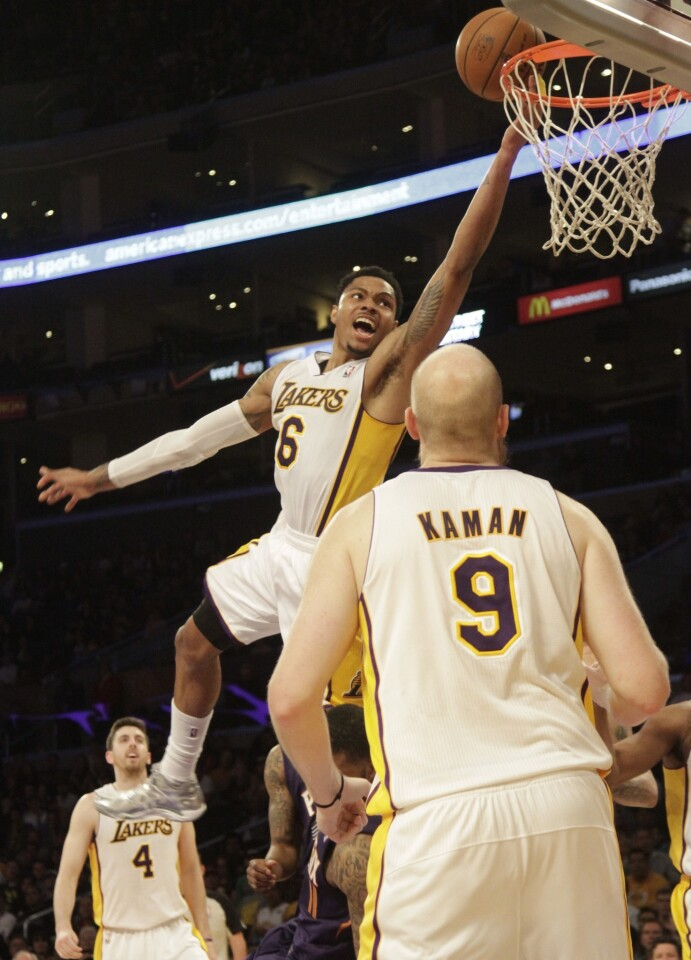 Lakers guard Kent Bazemore shoots a lay-up as teammate Chris Kaman looks on during the Lakers' 115-99 victory over the Phoenix Suns at Staples Center on Sunday.