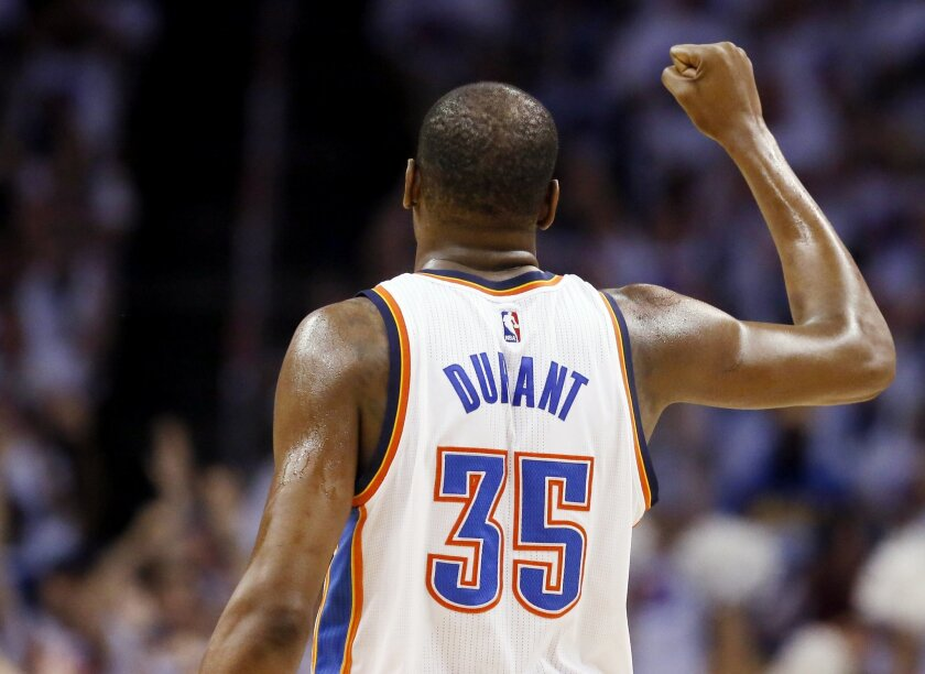 Oklahoma City Thunder forward Kevin Durant (35) raises a fist in celebration against the Golden State Warriors during the first half in Game 4 of the NBA basketball Western Conference finals in Oklahoma City, Tuesday, May 24, 2016. (AP Photo/Sue Ogrocki)