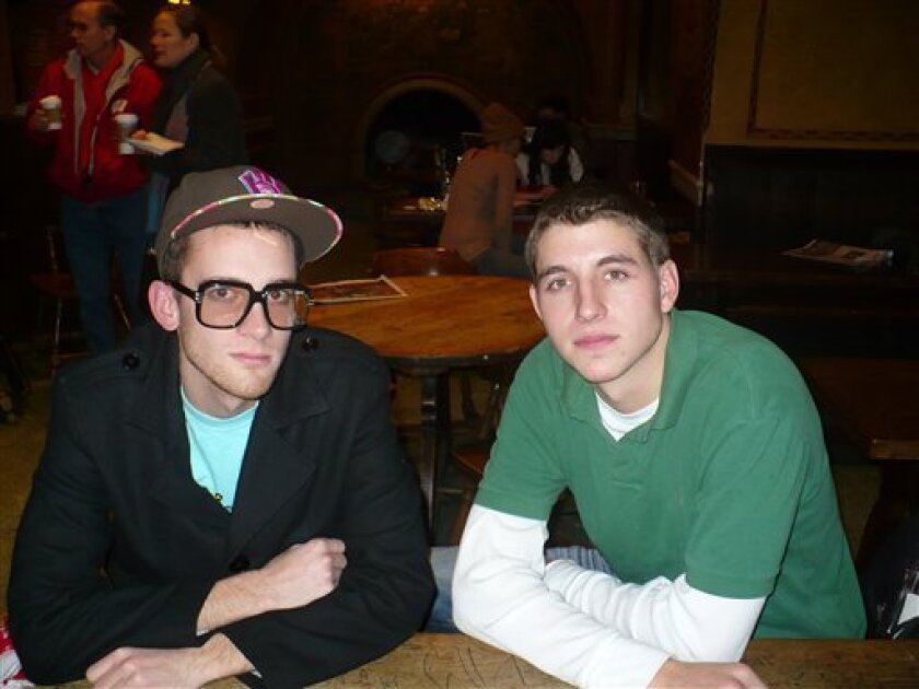 """In this photo taken Dec. 11, 2009, University of Wisconsin-Madison students Cliff Grefe, left, and Quincy Harrison are interviewed at the school's Memorial Union in Madison, Wis. The two undergraduate students have stirred up campus with their popular rap song and video, """"Coastie Song,"""" which some see as anti-Semitic and others call funny. (AP Photo/Ryan J. Foley)"""