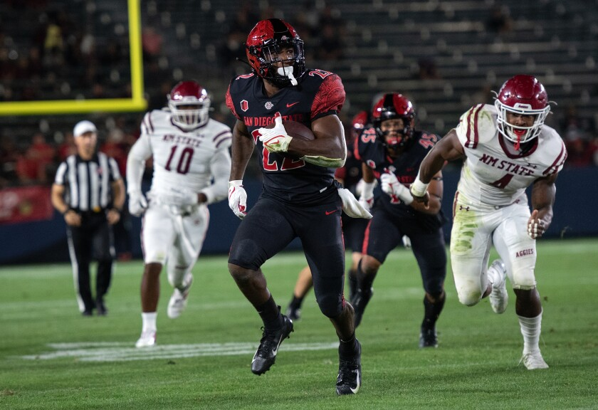 SDSU running back Greg Bell scores during 28-10 win over New Mexico State at Dignity Health Sport Park in Carson on Saturday.