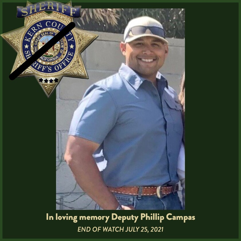 This undated memorial poster Courtesy of the Campas Family/Kern County Sheriff's Office posted on twitter shows Deputy Phillip Campas who was shot and killed on Sunday, July 25, 2021, at a residence in Wasco, Calif. The California sheriff's deputy was fatally shot this weekend when his SWAT team tried to rescue people held hostage inside a San Joaquin Valley home by a man armed with an AK-47-style rifle and a handgun, authorities said Monday. (Courtesy Campas Family/Kern County Sheriff's Office via AP)