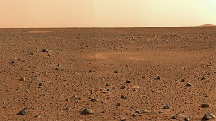 RED PLANET LANDSCAPE: An image taken by the Spirit rover shows the rocky surface of Mars and the Gusev Crater.