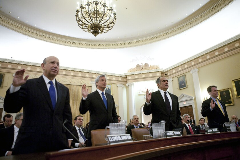 Leaders of four of the biggest U.S. banks -- left to right, Lloyd Blankfein, chairman and and chief executive officer of Goldman Sachs Group Inc.; Jamie Dimon, chairman, president and chief executive officer of JPMorgan Chase & Co.; John Mack, chairman of Morgan Stanley, and Brian Moynihan, president and chief executive officer of Bank of America Corp. -- are sworn in before testifying at a hearing of the Financial Crisis Inquiry Commission in 2010.
