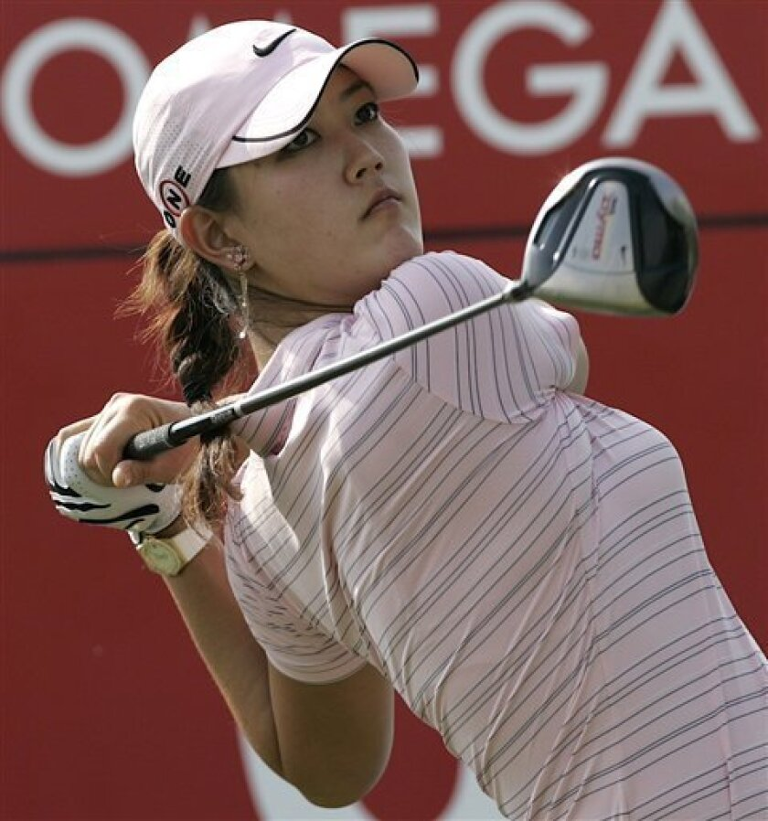 Michelle Wie of the US tees off on the 6th hole during the Second round of the Dubai Woman's Masters golf tournament in Dubai, United Arab Emirates Thursday, Dec. 10, 2009.(AP Photo/Nousha Salimi)