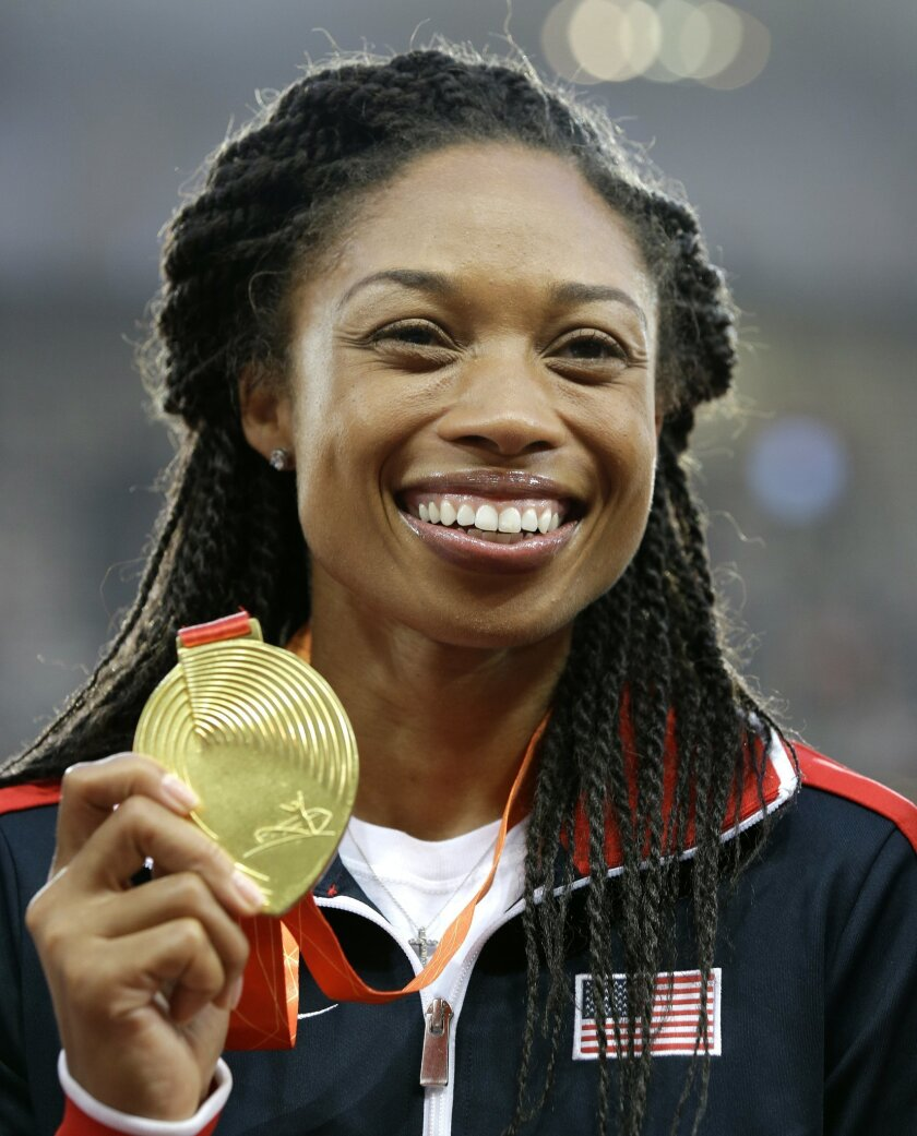 FILE - In this Aug. 28, 2015, file photo, women's 400-meter gold medalist Allyson Felix celebrates on the podium at the World Athletics Championships at the Bird's Nest stadium in Beijing. Now that international track and field officials have shifted the schedule at the Rio Olympics, American star