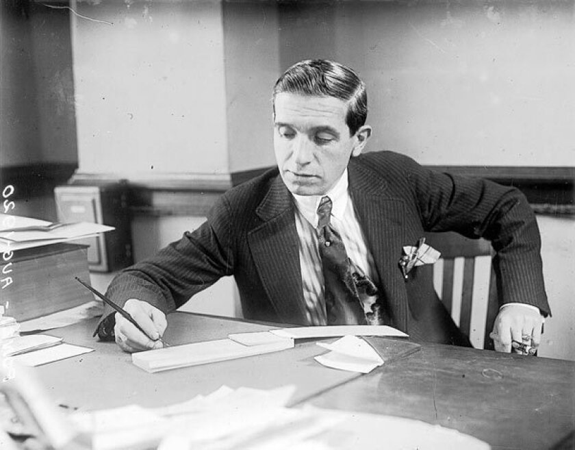 Charles Ponzi, seen in this 1920 photo, talked investors into sinking $10 million into a postal-currency scheme.