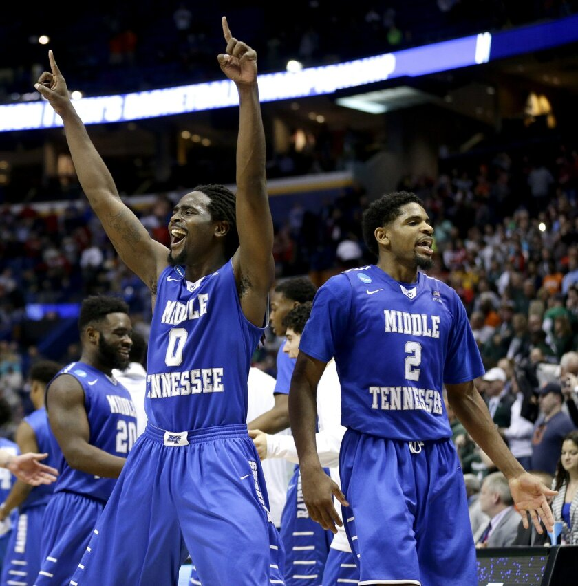 Middle Tennessee Darnell Harris (0) and Perrin Buford (2) celebrate as they walk off the court after winning a first-round men's college basketball game against Michigan State in the NCAA Tournament, Friday, March 18, 2016, in St. Louis. Middle Tennessee won 90-81. (AP Photo/Charlie Riedel)