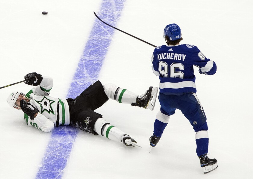Dallas Stars' Blake Comeau (15) is checked by Tampa Bay Lightning's Nikita Kucherov (86) during second-period NHL Stanley Cup finals hockey action in Edmonton, Alberta, Monday, Sept. 21, 2020. (Jason Franson/The Canadian Press via AP)