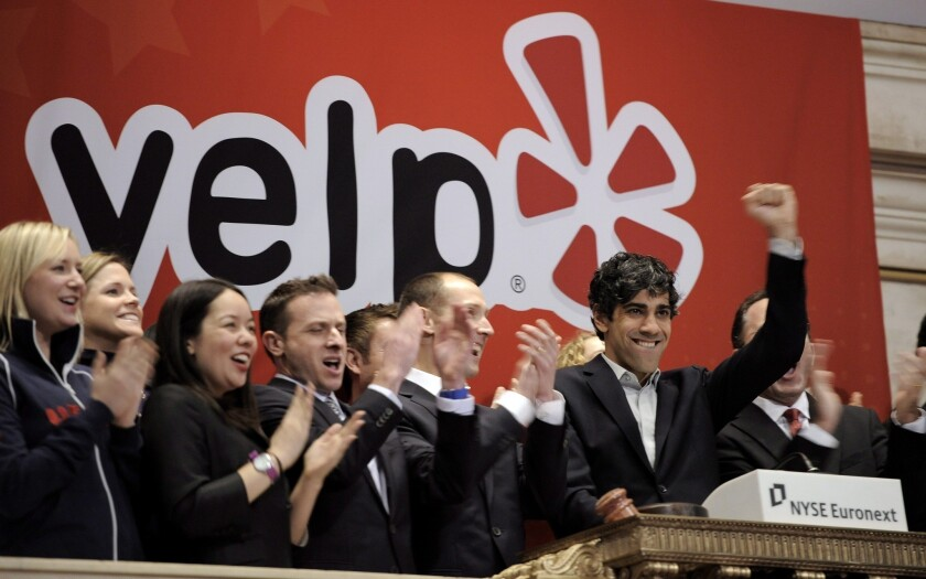 Jeremy Stoppelman, second from right, the chief executive of Yelp, celebrates while ringing the Opening Bell with employees during his company's initial public offering at the New York Stock Exchange in March of last year.