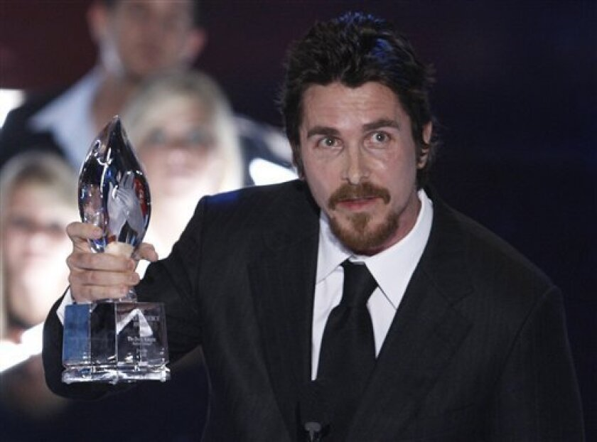 """Christian Bale accepts the favorite action movie award for """"The Dark Knight"""" at the 35th Annual People's Choice Awards on Wednesday Jan. 7, 2009 in Los Angeles. (AP Photo/Matt Sayles)"""