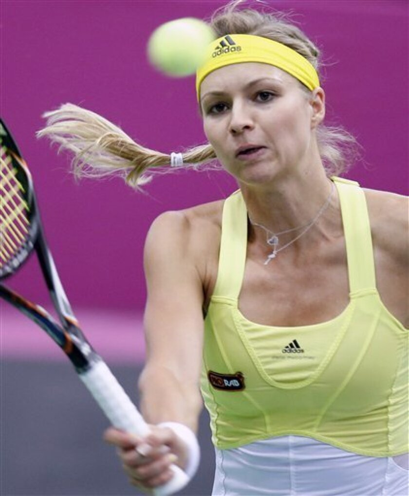 Russia's Maria Kirilenko returns a shot to Japan's Kimiko Date-Krumm during the Fed Cup match between Russia and Japan in Moscow, Russia, Saturday, Feb. 9, 2013. (AP Photo/Misha Japaridze)