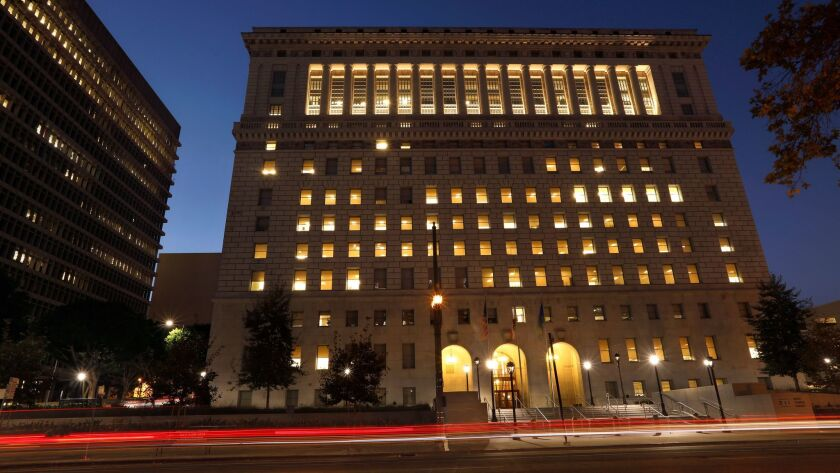 The L.A. County sheriff's headquarters in the Hall of Justice in downtown Los Angeles. The Sheriff's Department saw a 40% decline in new excessive-force lawsuits and a 33% drop in cases involving deputy-related shootings in the 2016-17 fiscal year.