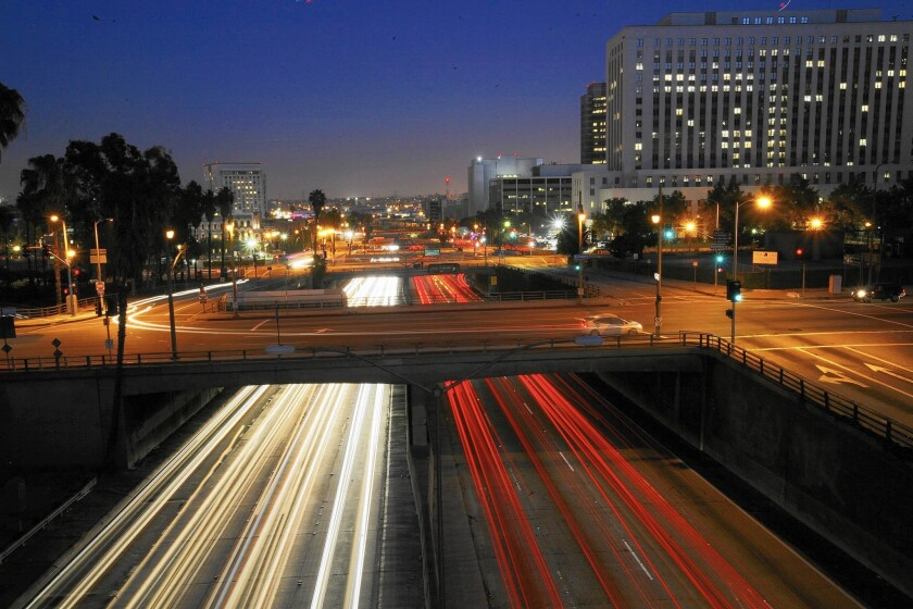 A view over the 101 Freeway southbound from the Hill Street bridge.