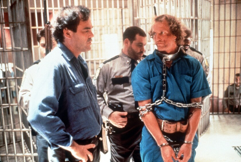 Oliver Stone and Woody Harrelson on the set of