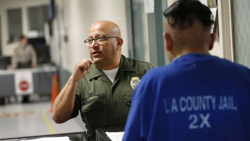 LOS ANGELES, CA - MAY 13, 2019 - Los Angeles County Sheriff Custody Assistant Rodolfo Cabrera, left,