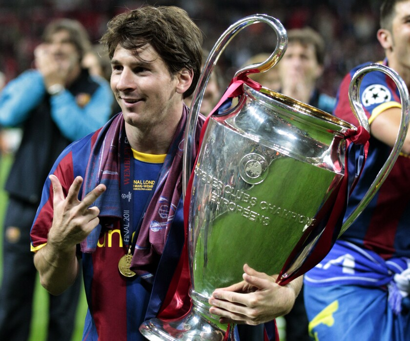FILE - In this May 28, 2011 file photo Barcelona's Lionel Messi celebrates with the trophy after winning the Champions League final soccer match against Manchester United at Wembley Stadium, London. Barcelona announced Thursday Aug. 5, 2021 that Lionel Messi will not stay with the club. He is leaving after 17 successful seasons in which he propelled the Catalan club to glory, helping it win numerous domestic and international titles since debuting as a teenager. (AP Photo/Jon Super, File)