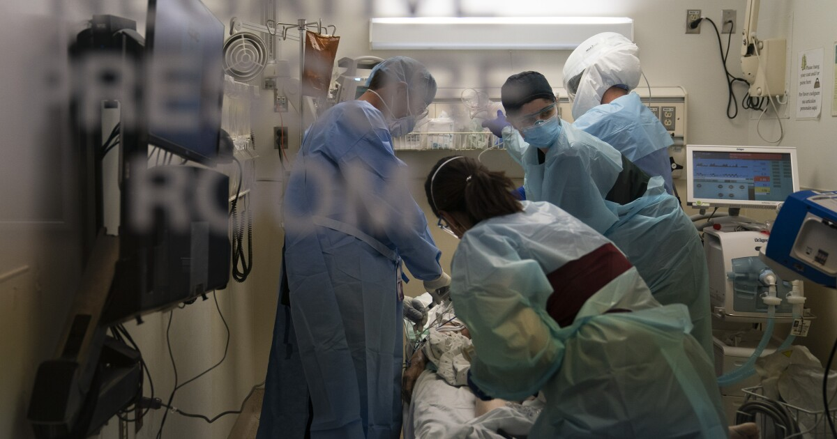 Coronavirus hospitalizations surge to unprecedented level as L.A. announces stay-at-home rules