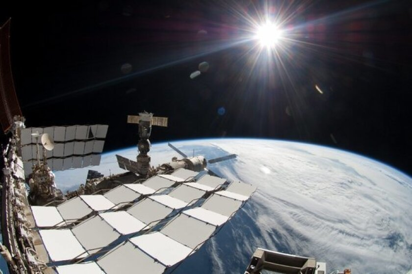 A $2-billion cosmic ray detector on the International Space Station has found the footprint of something that could be dark matter, the mysterious substance that is believed to hold the cosmos together but has never been directly observed, scientists say.