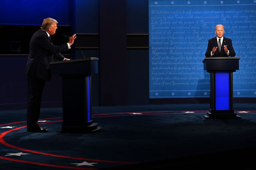 President Trump, left, and former Vice President Joe Biden spar during their first debate Tuesday in Cleveland.