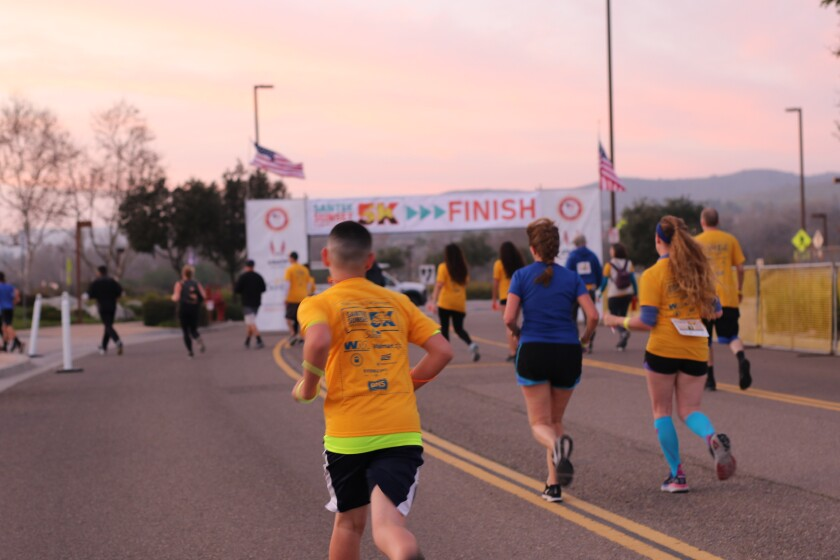 Runners approach the finish line in the 2020 Santee Sunset 5K. This year's race is virtual and takes place in February.