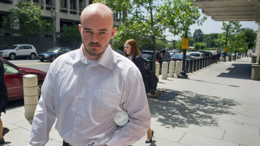 Former Blackwater Worldwide guard Nicholas Slatten leaves federal court in Washington on June 11, 2014.