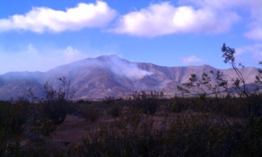 Smoke from the Banner fire hovered over the Anza-Borrego Desert Friday after sunrise.