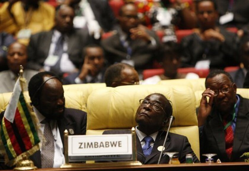 Zimbabwe's President Robert Mugabe attends the opening session of the 13th African Union summit of heads of state and government in Sirte, Libya, Wednesday, July 1, 2009. (AP Photo / Nasser Nasser)