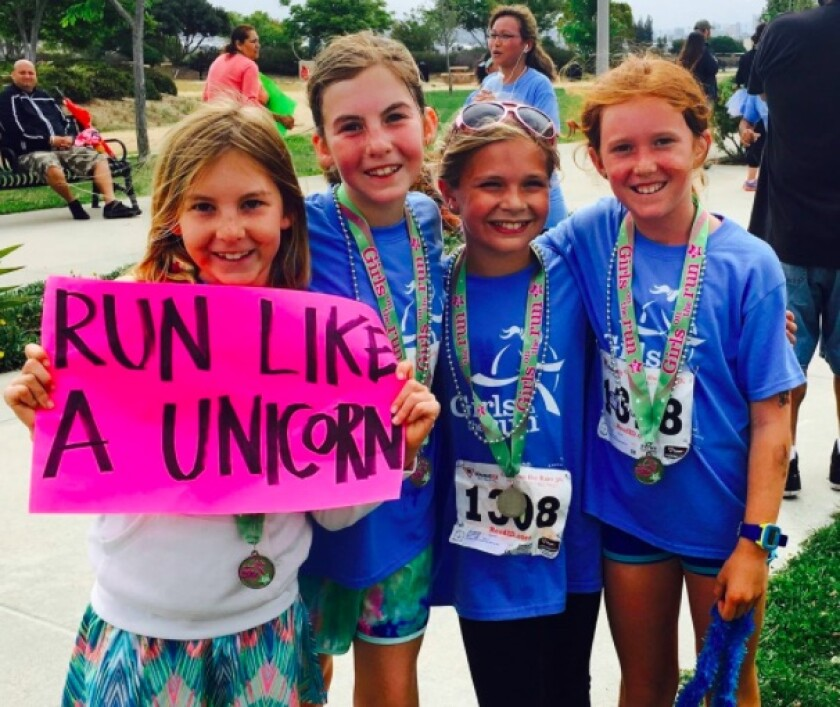 Participants in a past Girls on the Run 5K event. This year's race will be virtual May 9 through June 9.