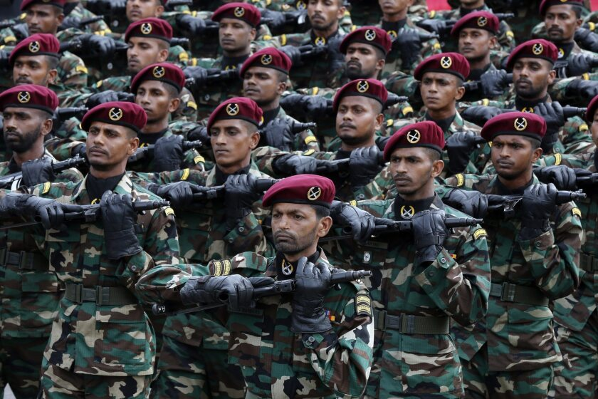 Soldiers of the Sri Lanka Army Commando Regiment's Maroon Berets march during a parade in Colombo, Sri Lanka, on Feb. 4.