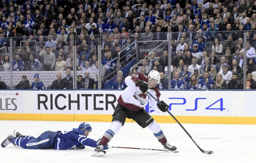 Colorado Avalanche right wing Valeri Nichushkin (13) gets a breakaway as Toronto Maple Leafs defenseman Morgan Rielly (44) dives to stop him during the third period of an NHL hockey game, Wednesday, Dec. 4, 2019 in Toronto. (Nathan Denette/The Canadian Press via AP)