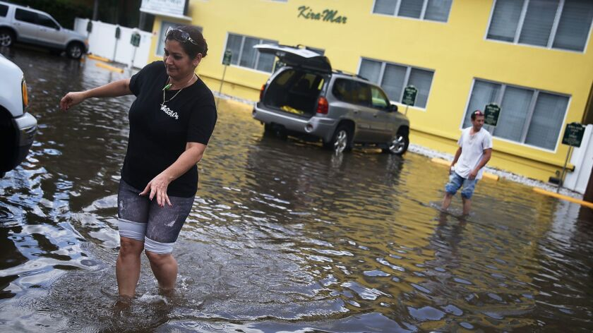 Fort Lauderdale, Fla., is among coastal regions seeing increased flooding from high tides atop rising seas.