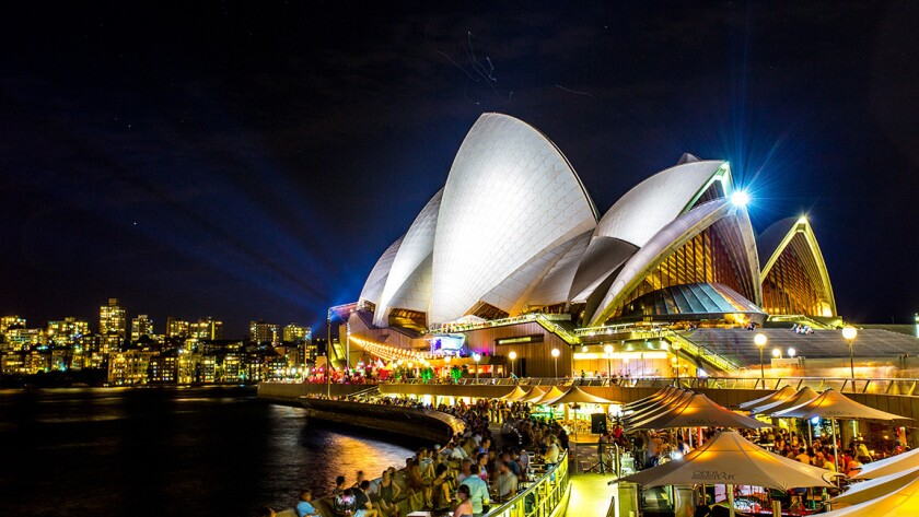 Sydney's iconic opera house lights up the landscape. Qantas has round-trip fares to Sydney or Melbourne for $929.