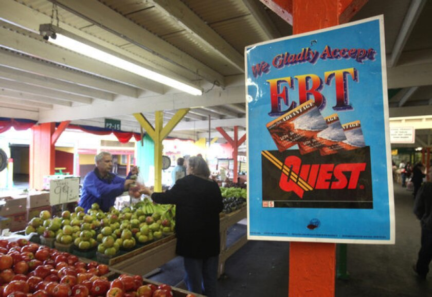 Electronic Benefit Transfer cards are accepted at a farmers market in Roseville, Calif.