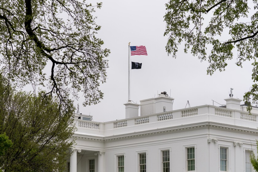 A POW/MIA flag, symbolizing America's Missing in Action and Prisoners of War, flies above the White House, Friday