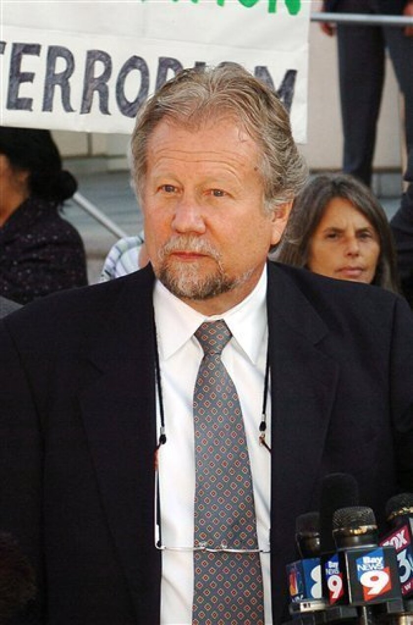 FILE - In this May 1, 2006 file photo, Attorney C. Peter Erlinder talk to members of the media outside the federal courthouse building in Tampa, Fla. (AP Photo/Steve Nesius, File)