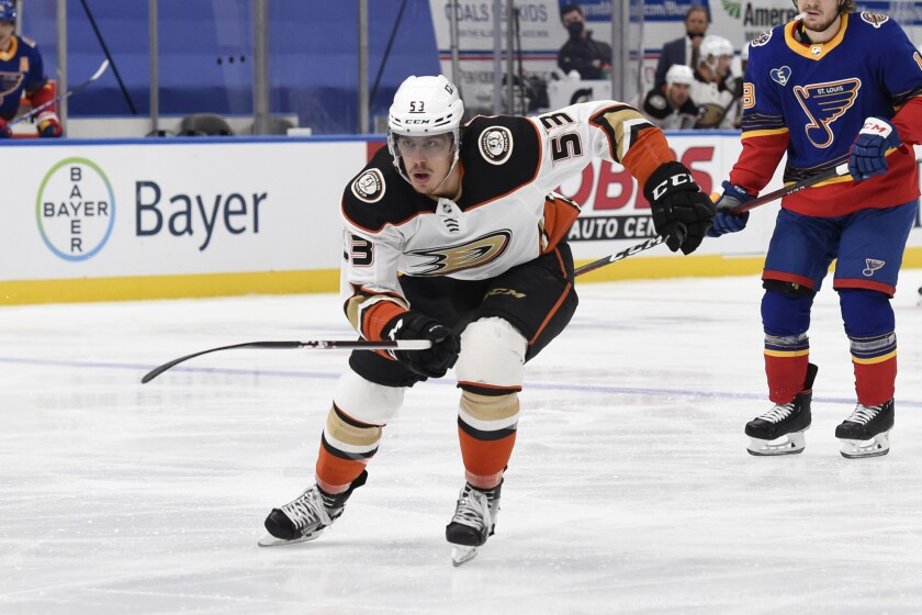 Ducks forward Max Comtois chases the puck during a game against the St. Louis Blues in May.