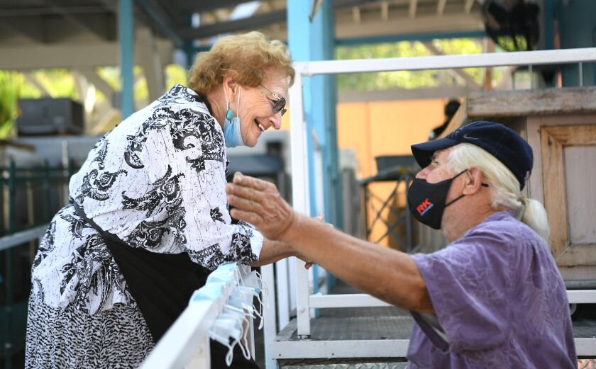 Gloria Suess talks to a friend at Mary's Kitchen in Orange.