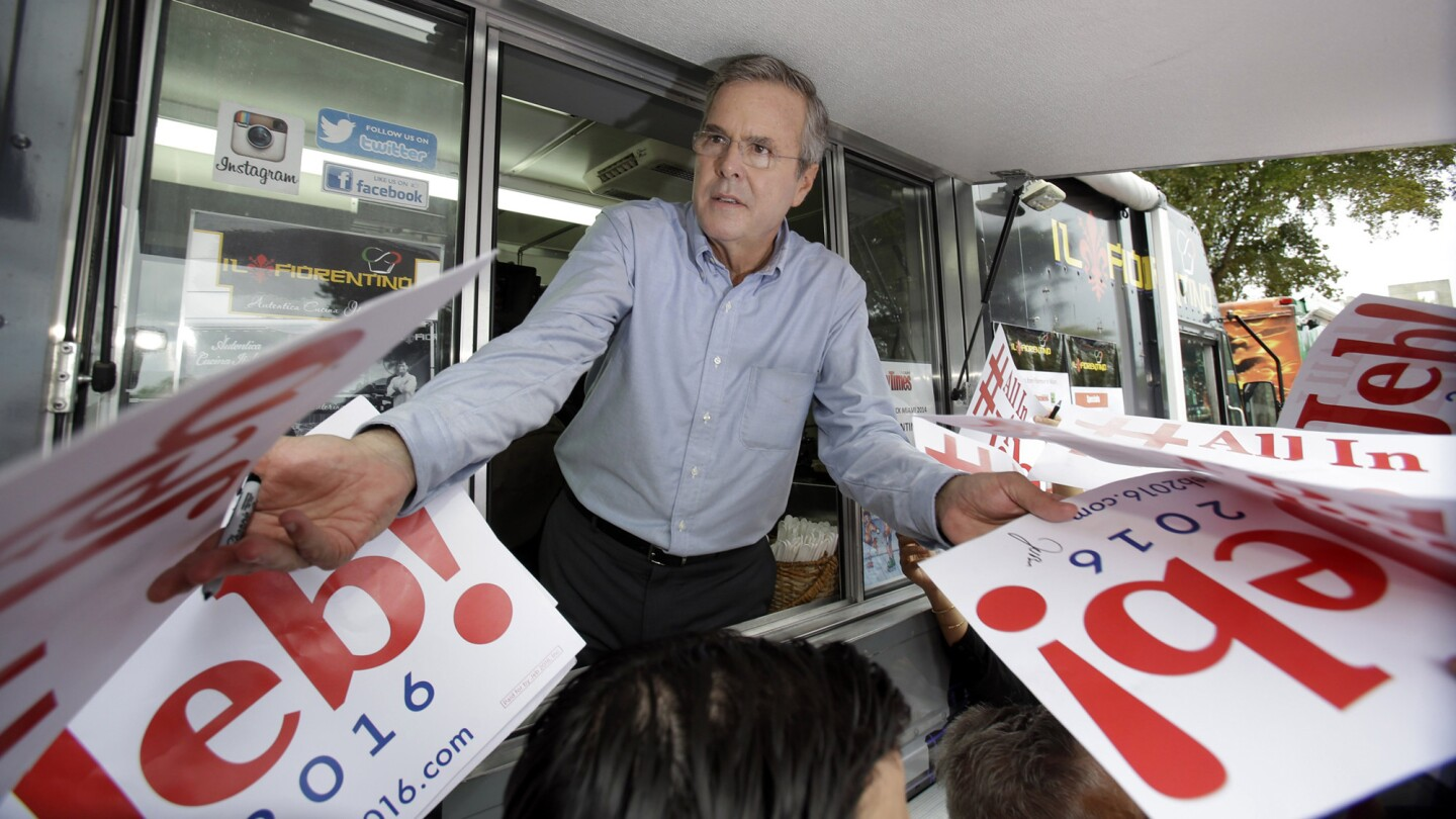 Former Florida Gov. Jeb Bush signs autographs from the window of a food truck after he formally announced that he would join the race for president with a speech at Miami Dade College on June 15.