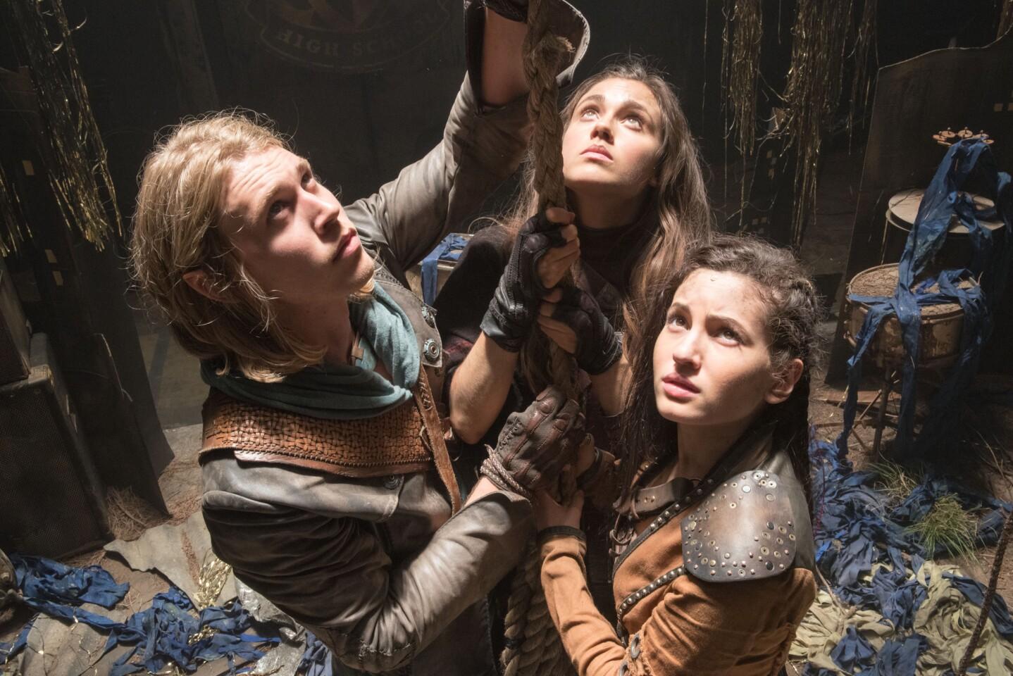 "Wil (Austin Butler), Amberle (Poppy Drayton), center, and Eretria (Ivana Baquero) in ""The Shannara Chronicles."""