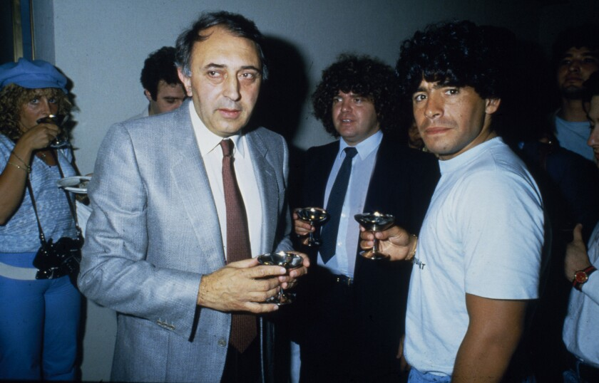 Diego Maradona is greeted by club president Corrado Ferlaino after joining Italian power Napoli in July 1984, when he was 23.