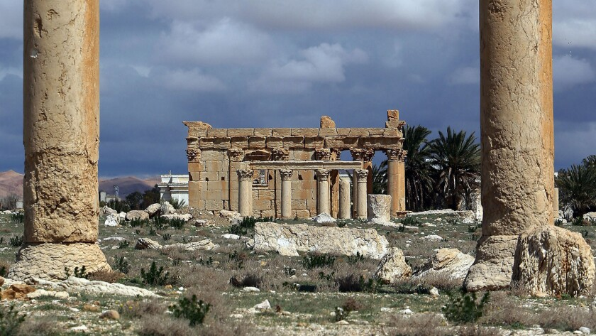 A picture taken on March 14, 2014, shows the Temple of Baalshamin, seen between two Corinthian columns in the ancient oasis city of Palmyra, Syria.