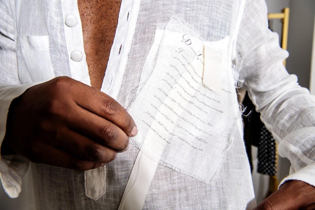 Designer Kenneth Nicholson wears a white gauze Dorcas tunic.